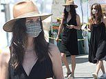 Courteney Cox shows summer style at farmer's market in LA donning black dress with a matching mask