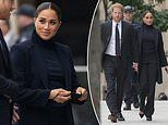 She means business! Meghan Markle is understated in a navy coat and wide-legged trousers