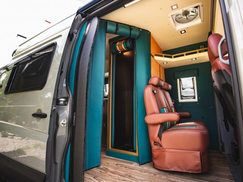 This custom tiny home on wheels was built inside Mercedes-Benz Sprinter van and designed to be lightweight with cot beds - see inside