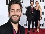 Thomas Rhett is honored at BMI Country Awards as wife Lauren stuns in low-cut sleeveless black dress