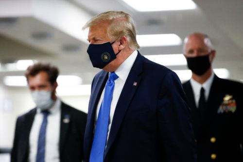 Donald Trump visits Walter Reed National Military Medical Center. and wears a mask