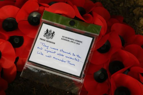 Theresa May pays armistice tribute to killed British soldiers