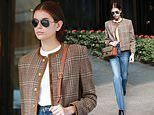Kaia Gerber steps out in Milan in a chic tweed blazer over a classic white Tee