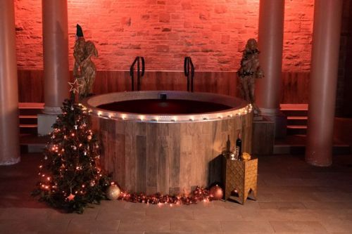 You can book a mulled wine themed spa day in the UK with a wine-filled hot tub