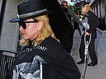 Madonna, 61, emerges from hospital using a crutch amid recovery from knee injury
