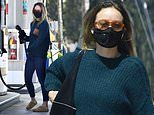 Olivia Wilde dons a face mask while on a solo shopping trip but still goes gloveless to pump gas