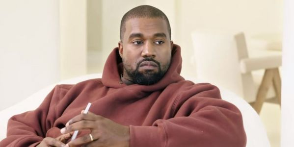 Who is Kanye West's cousin in prison for murder and who did he kill?