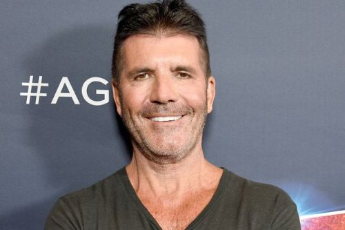 Simon Cowell could have been paralysed with fracture '1cm from his spinal cord'