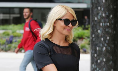 Holly Willoughby spotted shopping with family in Marks & Spencer - in GORGEOUS £1800 coat