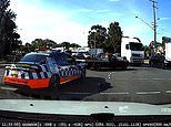 Driver runs a red light and almost ploughs into oncoming traffic - right in front of a police car