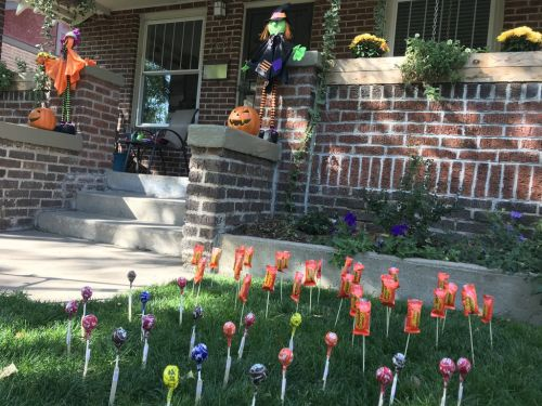 Mum creates 'candy garden' to allow kids to safely trick or treat from a distance
