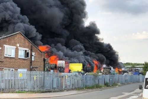 Huge clouds of smoke and fire tower above homes as industrial estate blazes