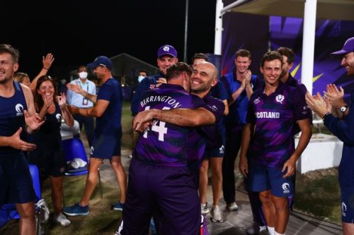 Scotland reach T20 World Cup Super 12s for the first time with historic victory over Oman