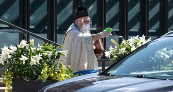 US Priest Goes Viral After Using Squirt Gun Full Of Holy Water To Bless Churchgoers