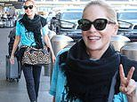 Sharon Stone grins ear-to-ear as she arrives at LAX airport in a relaxed T-shirt and black jeans