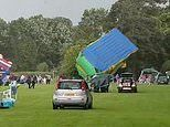 Freak tornado sends huge bouncy castle flying through the air injuring up to three at park event