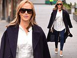 Amanda Holden looks chic in a stylish winter coat and skinny form-fitting jeans