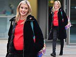 Rachel Riley shields her baby bump from the cold in a bright red jumper as she heads home