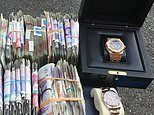 Police seize £100,000 cash and luxury watches in south London drugs raid