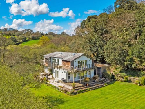 House that offers the best of both worlds - as it's in the woods but has stunning sea views - on sale for £1.5million