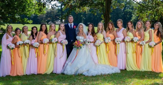 Woman has 15 bridesmaids on her wedding day because she can't leave anyone out
