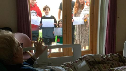 Down mum has Mother's Day to remember as her family gathers outside window at hospice