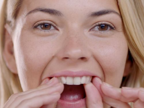We asked an orthodontist if it's safe to use Crest Whitestrips as an at-home teeth-whitening treatment - here's what they said