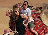 Catherine Tyldesley is nearly thrown off a camel in hilarious honeymoon throwback snap