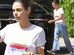 Mila Kunis channels That 70s Show chic in hipster-style boot-leg jeans with frayed hems