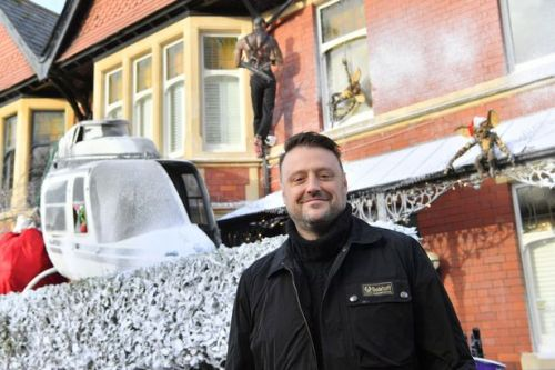 Man creates entire Christmas movie in front garden with helicopter and fake snow