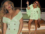 Beyonce highlights her toned thighs in a little green dress while living up on a luxury yacht