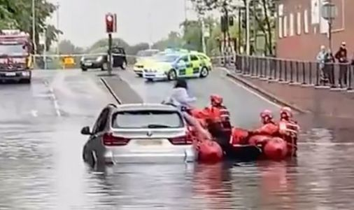London flooding: Family saved via raft after driving car into a few feet of water - VIDEO