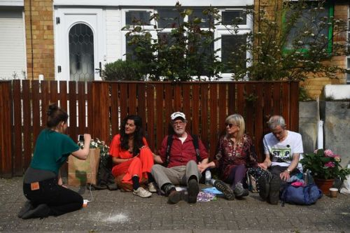 Climate change activists glue themselves to fence outside Jeremy Corbyn's house