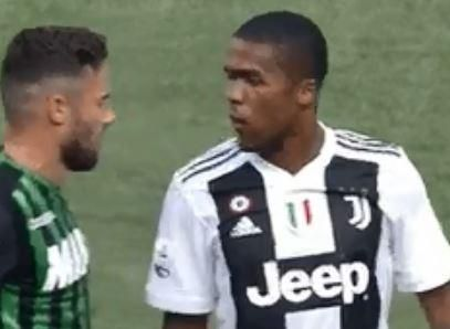 Juventus' Douglas Costa sent off after VAR shows Brazilian spitting, headbutting and elbowing Sassuolo player in face