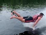 Showboating! Daredevil performs PRESS-UPS while water skiing backwards on one foot. without skis