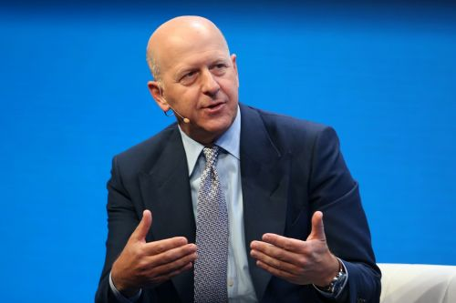 Goldman Sachs will pay nearly $3 billion to settle US charges over its 1MDB scandal and will reduce the pay of CEO David Solomon and top executives