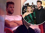 Liam Hemsworth looks downcast as he watches an AFL game in Melbourne