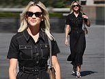 Ashley Roberts beams in denim belted midi dress and chunky trainers