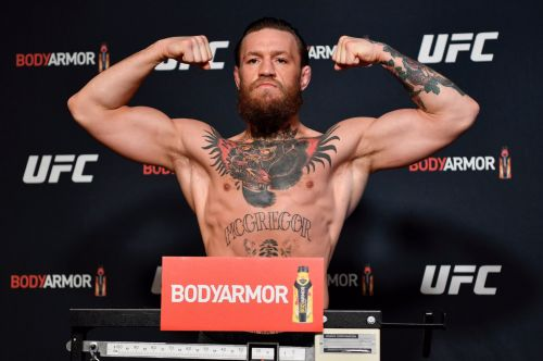 UFC star Conor McGregor looks huge on scales as he weighs in for Donald Cerrone fight