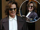 Sigourney Weaver beams in aubergine-coloured trench coat as she steps out during Milan Fashion Week
