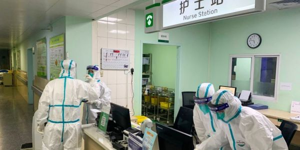 As the Wuhan virus spreads, doctors in Wuhan say they face a 'flooding' of patients and not enough protective gear