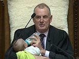 New Zealand parliament speaker cradles a fellow MP's baby son