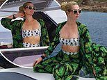 Paris Hilton shows off taut tummy lounging on a luxury catamaran in Corsica