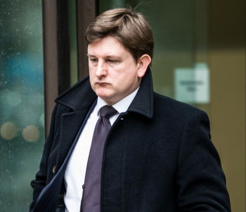 Lawyer punched fellow opera fan who grabbed wife's coat and threw it on her