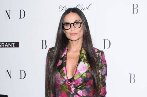 Demi Moore makes surprise appearance at Bruce Willis comedy roast