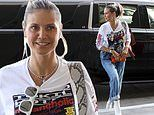 Heidi Klum is a supportive band wife as she jets out of LAX