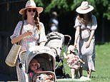 Pregnant Millie Mackintosh showcases her growing baby bump in a floral midi dress
