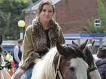 Travellers parade through the streets of Appleby dressed to the nines and on horseback