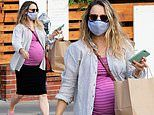Pregnant Rachel McAdams displays her growing baby bump while grabbing takeout in Los Feliz