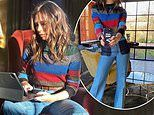Victoria Beckham goes for 70s glamour in a colourful striped jumper and flared jeans
